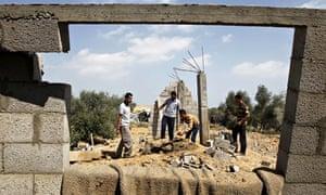 Palestinians inspect a damaged building