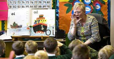 Margaret Mooney gets her young class to shout of the vowel sound 'oi' as part of phonics teaching.