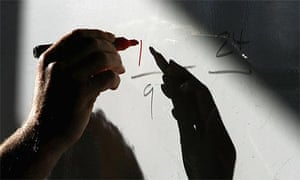 Maths sums on a whiteboard