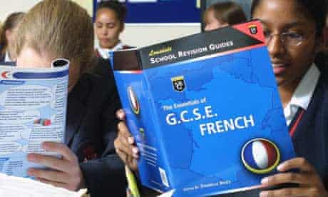 Children using modern languages schoolbooks in the classroom