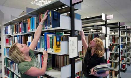 Students looking for books in the university library
