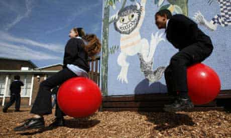 Children playing in the playground at St Elizabeth Catholic primary school, Bethnal Green, east London