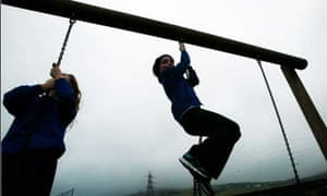 Children playing in the playground at Burlington primary school at Kirby-in-Furness in Cumbria