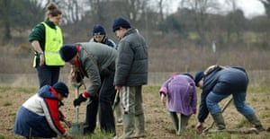 Children from Beckett Primary School, Derby, planting trees in the National Forest near Swadlincote