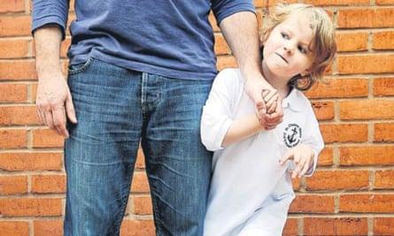 Child attached to parent's leg