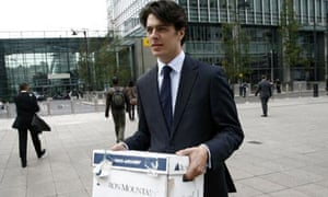 A Lehman Brothers employee carries a box