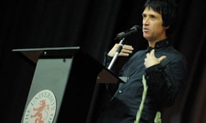 Johnny Marr, with accompanying gladioli, gives his first lecture at University of Salford