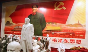 Communist portraits and busts of Stalin and Mao Zedong
