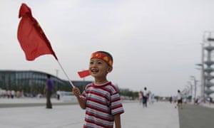 Child outside the Bird's Nest Stadium in Beijing