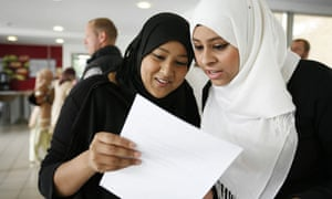 Pupils, girls, collect their GCSE results at Morpeth School in Bow, East London