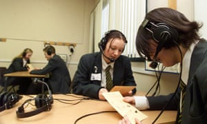 Secondary school pupils practise in a language lab