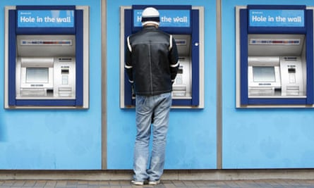 A man uses a cashpoint machine