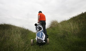 Golfer at the Royal Birkdale golf course, Southport