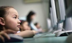 Schoolgirl working on computer