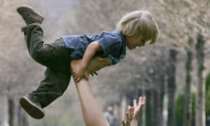 Lindsay Grieves balances her four year-old son, Sebastian, on her feet while playing in the grass