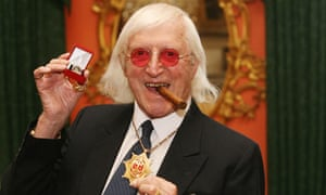 Sir Jimmy Savile after he received a commemorative badge from Prime Minister Gordon Brown