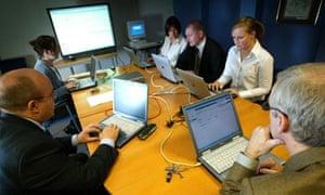 Teachers at a computer session at De La Salle school