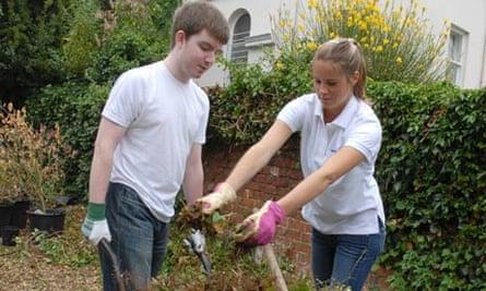 Gloucestershire University students Matt Brooks and Jessica Earp work at the Park campus allotment