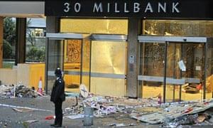 Lone policeman surveys Millbank damage after demo