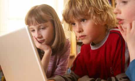 Children work on computer