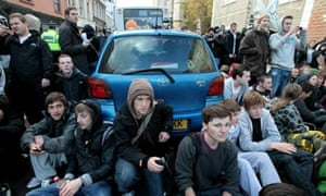 Students in Bristol block cars during a protest against tuition fees and cuts