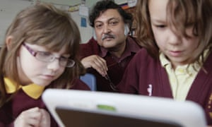 Prof Sugata Mitra, who inspired Slumdog Millionaire with pupils at St Aidan's primary, Gateshead