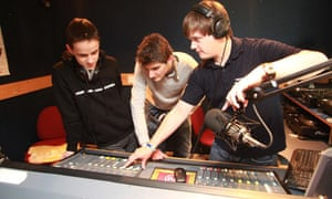 Student Matt Clifford trains new recruits at GU2, Surrey University's student radio station