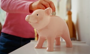 Young girl saves money in piggy bank