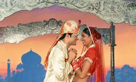 Scene from a Bollywood film: Indian bride and groom in front of a Taj Mahal backdrop