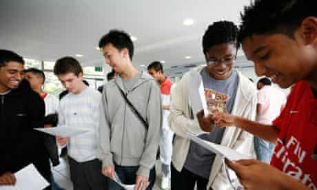 Boys collect their GCSE results. More exam-like conditions may favour them in the future