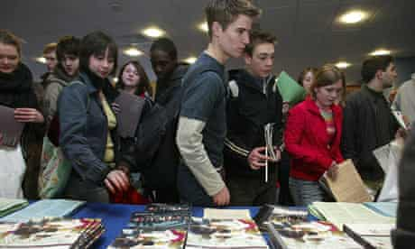 Sixth-formers pick up Oxbridge university prospectuses at an event held in Leicester