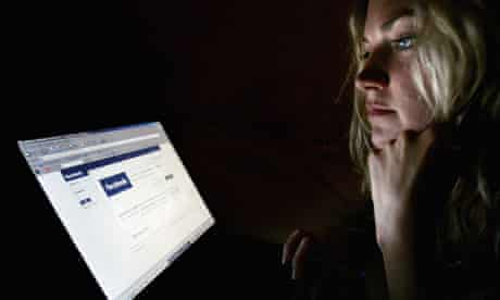 Woman looks at facebook