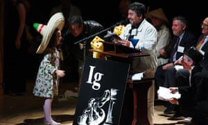 Miss Sweetie Poo with Javier Morales (right) and Miguel Apatiga at the 2009 Ig Nobel prize ceremony