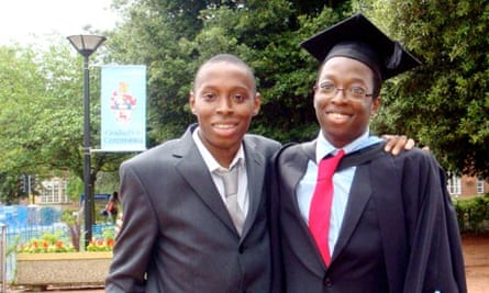 Toby Bakare, right, at his degree ceremony with his brother, Ayo