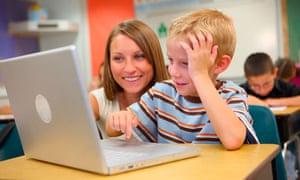 Teacher and school student working on laptop