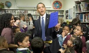 US President Barack Obama (C) looks at c