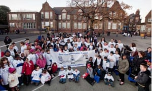 Pupils and parents at Downhills primary in north London protest against plans to make it an academy