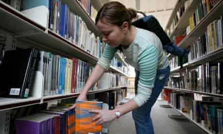 A student chooses a book in the library