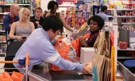 Shoppers in Sainsbury's