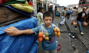 José, 13, sells fruit on buses in Guatemala City, but dreams of becoming a teacher