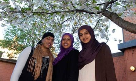 Firzana Khan (left), tutor, with Shukri Hassan and Sharifa Aliyah, former students