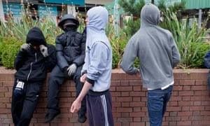 Youths gather in the centre of West Bromwich in late afternoon,