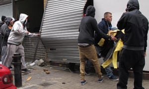 Youths loot a store in Hackney during the riots in London.