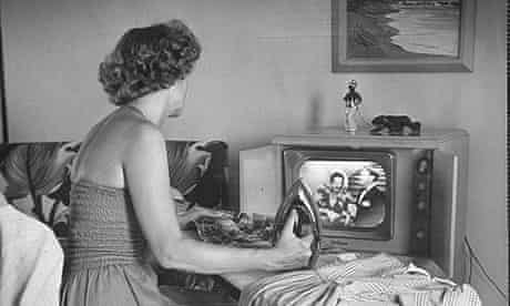 woman watching tv in 50s
