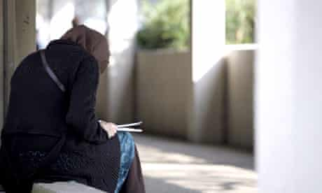 Muslim female student reading