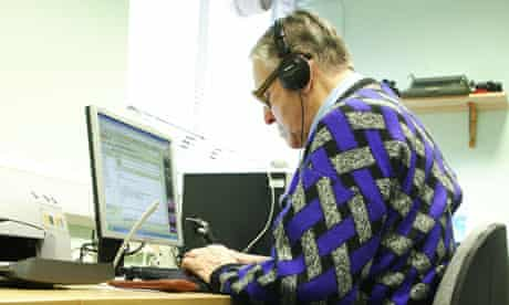 An elderly man uses a computer at the Resource Centre in Newham, east London