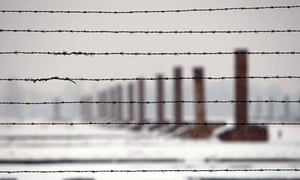 Chimneys seen through barbed wires at the Auschwitz-Birkenau death camp in Oswiecim