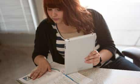 Girl with ipad doing maths