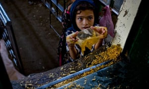 A little girl receives free food on World Food Day in 2010 in Islamabad, Pakistan