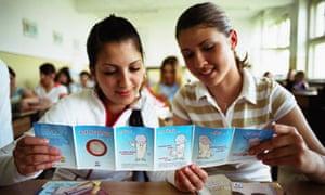 High school students examine a condom advice leaflet